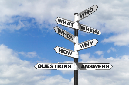 """Post with arrow signs saying """"Who"""", """"What"""", """"Where"""", """"When"""", """"Why"""", """"How"""", """"Questions"""", """"Answers"""""""