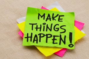 "Pile of post-it notes, top one says ""Make things happen!"""