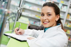 Smiling female doctor writing notes on a clipboard