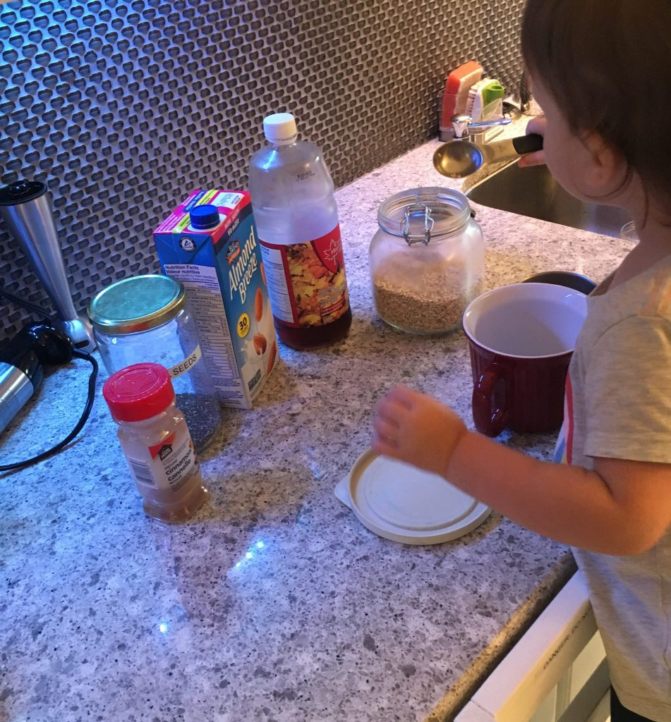 Toddler helping to make overnight oats
